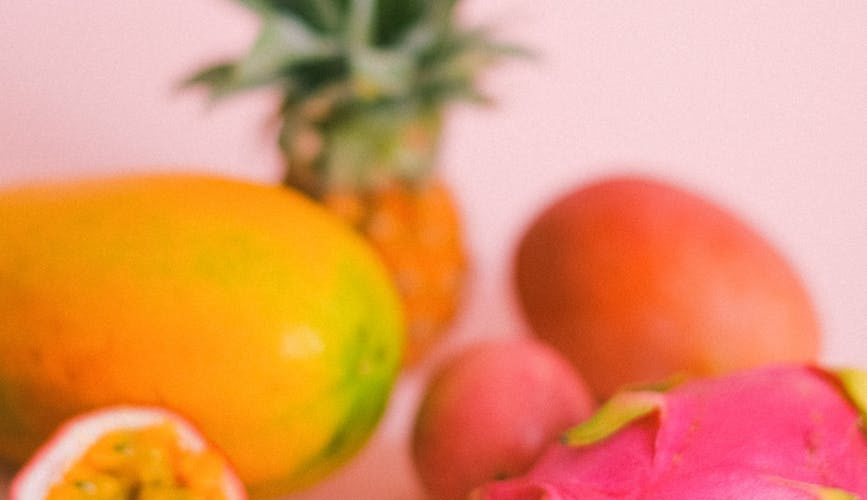 tropical fruits composition on pink background