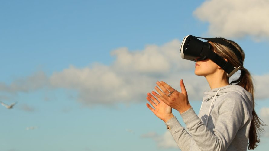 woman using vr goggles outdoors